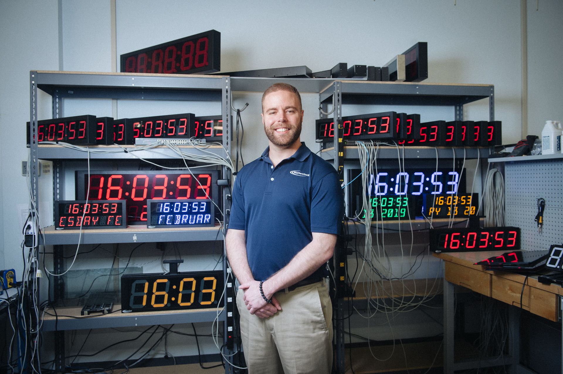 Masterclock CEO John Clark examines a time-keeping device.