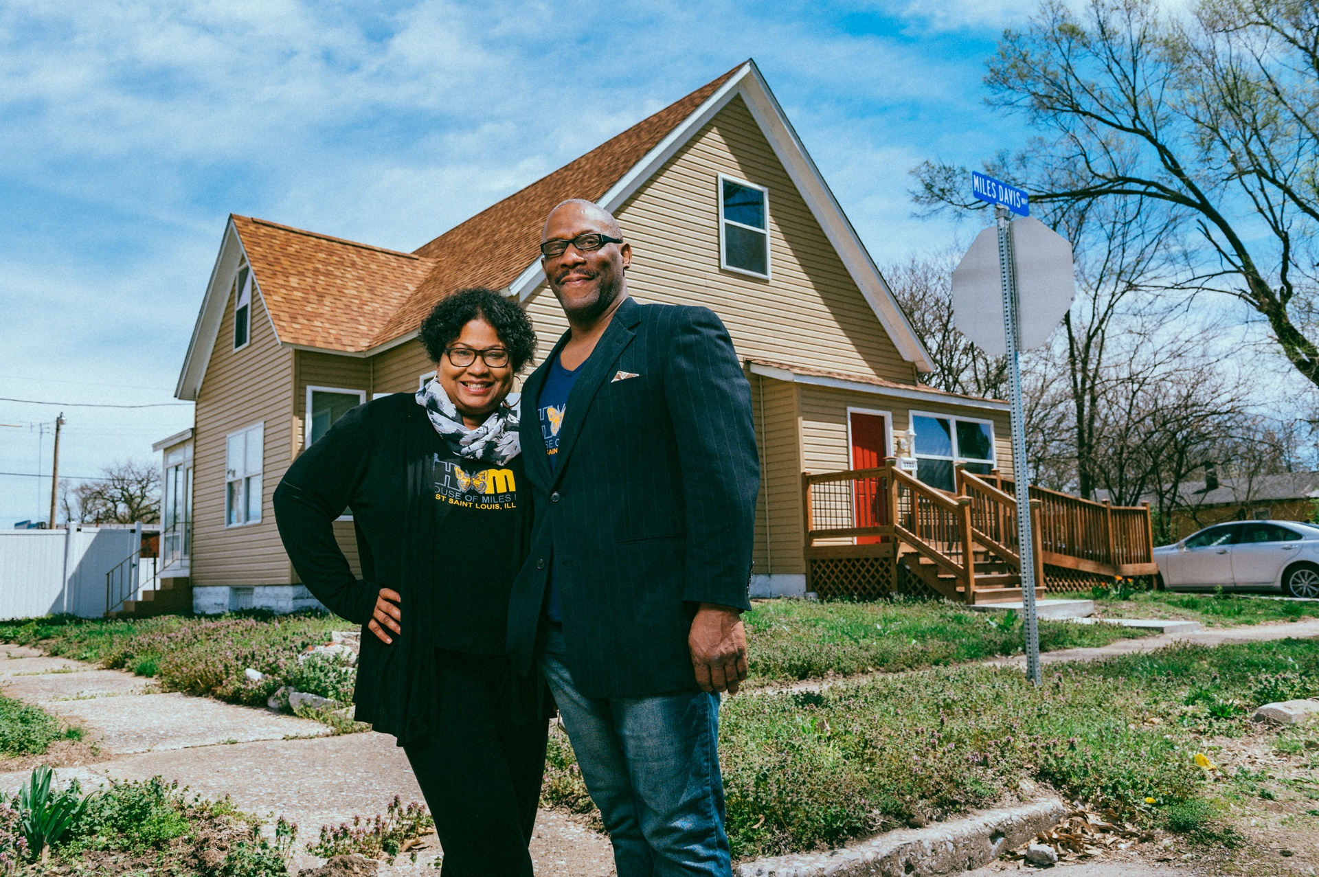 Lauren Parks and Jas Gary Pearson outside the childhood home of Miles Davis