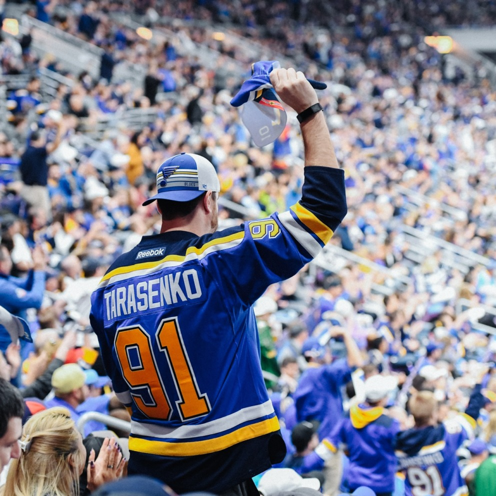 Fan at blues game wearing Tarasenko jersey.