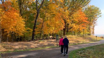 Couple walks one of the paved trails of Cliff Cave Park, in South St. Louis County.